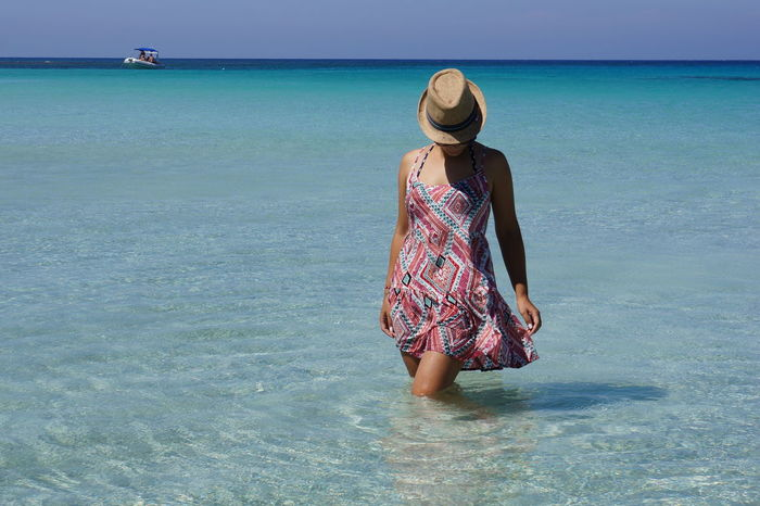 Adult Bay Beach Beauty In Nature Blue Blue Lagoon Cyprus Day Girl Holidays Horizon Over Water Mediterranean Sea One Person One Woman Only Outdoors Summer Sunlight Tourism Travel Turquoise Vacations Water Woman In Dress