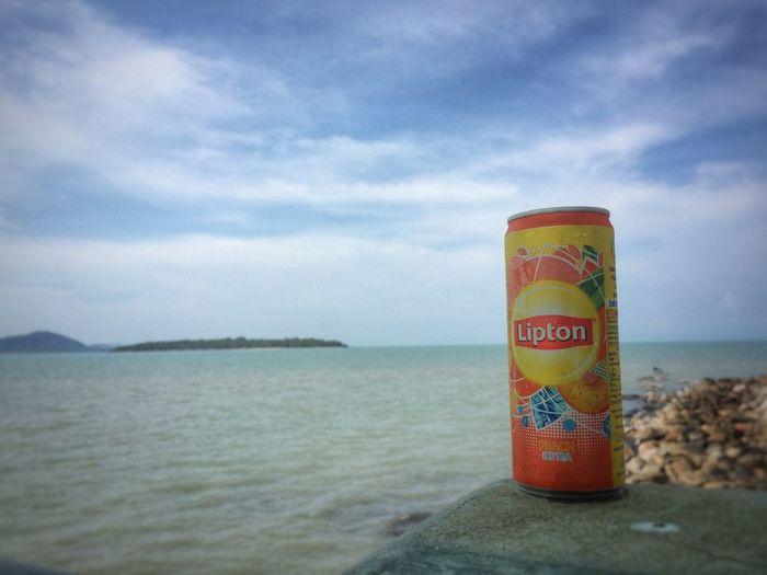 Can Clouds Horizon Over Water Island Lipton Ice Tea No People Sea Sky