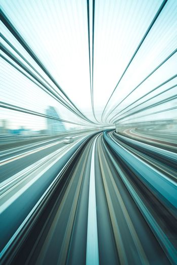 Blurred motion of railroad tracks in city