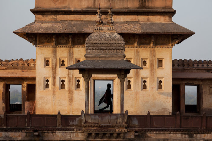 Silhouette of an Indian lady passing by the corridor in Jehangir Mahal (Orchha Fort) in Orchha, India Ancient ASIA Building Female Fort India Landmark Lifestyle Old Orchha Palace People Raja Religion Silhouette Travel EyeEmNewHere EyeEmNewHere Welcome Weekly