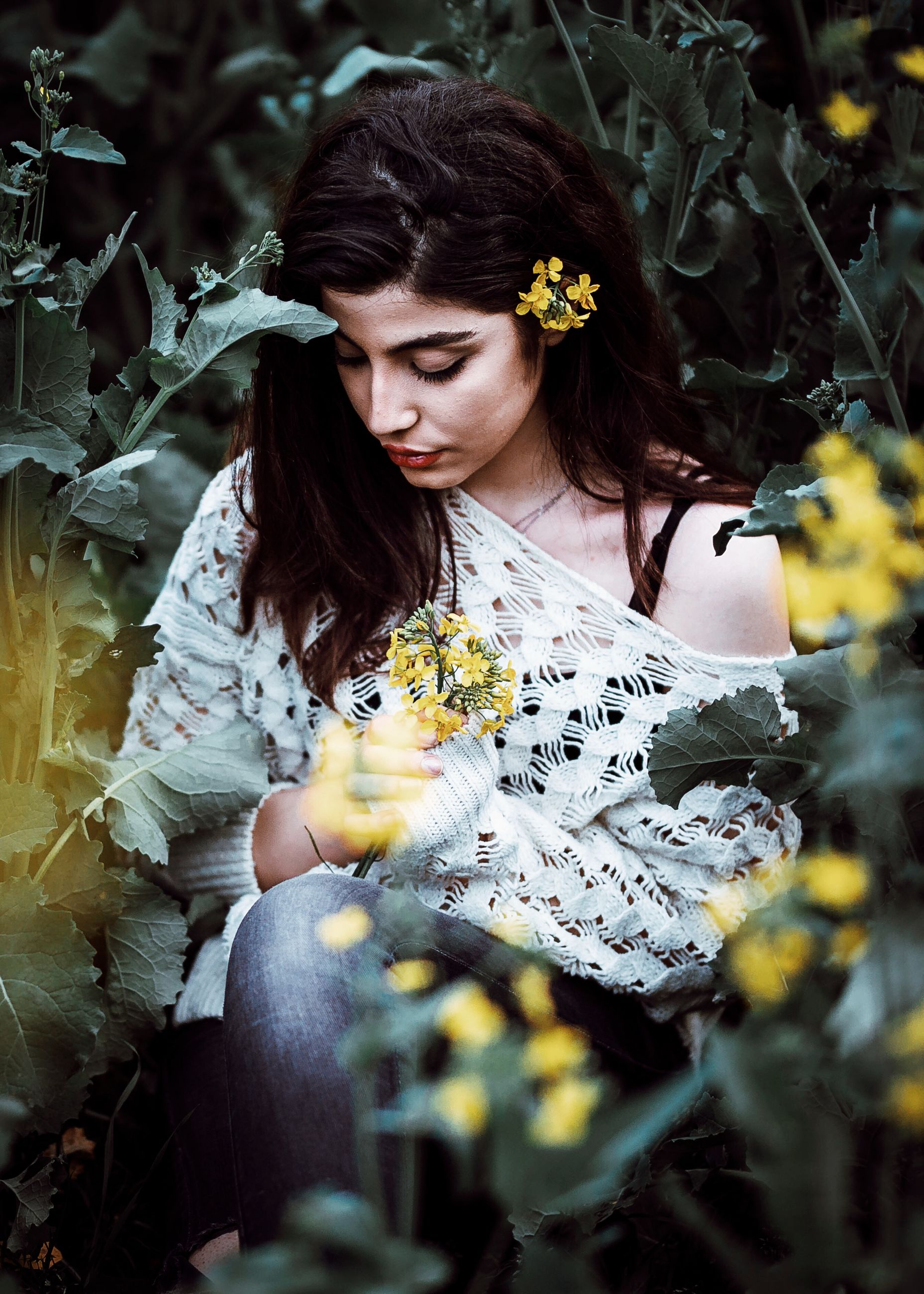 young adult, one person, real people, young women, flower, beautiful woman, outdoors, leisure activity, day, nature, lifestyles, plant, leaf, beauty in nature, fragility, one young woman only, tree, freshness, people