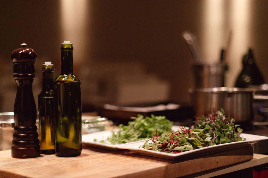 Salad Alcohol Bottle Close-up Container Domestic Room Drink Focus On Foreground Food Food And Drink Freshness Herb Indoors  Kitchen No People Oil Bottle Pepper Refreshment Selective Focus Still Life Table Vegetable