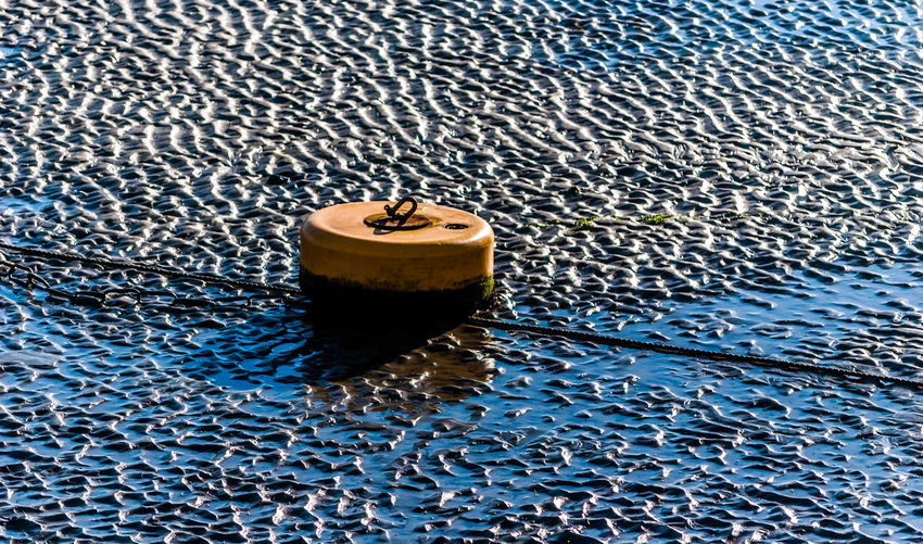 High Angle View Of Buoy And Rope At Beach