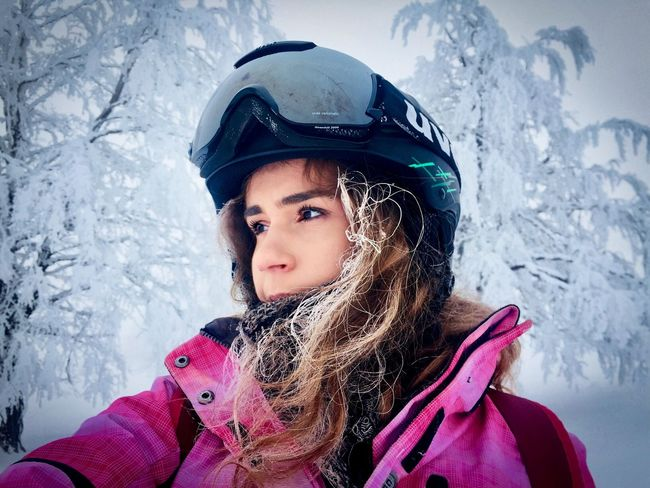 Portrait of woman with frozen hair and Uvex ski glasses surrounded by trees covered in snow Trees Forest Fog Cold Ski Helmet Ski Glasses Uvex Skiing Skier Woman Portrait Face Winter Snow Cold Temperature Warm Clothing Portrait Weather One Person Headwear Front View Outdoors Headshot Frozen One Girl Only Day Nature Real People