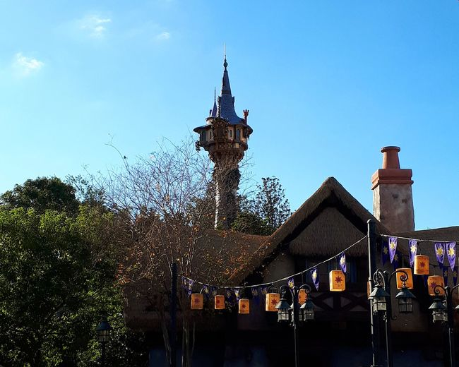 Who is in the tower? Blue Sky Peaceful Castle Tower Disney Disneyland Blue Colorful Tourism Destination Tower Fairytale  Tangled Old Buildings Old Town Fairytale Town Landscape Building Medieval Medieval Architecture MedievalTown Medieval Village Village View