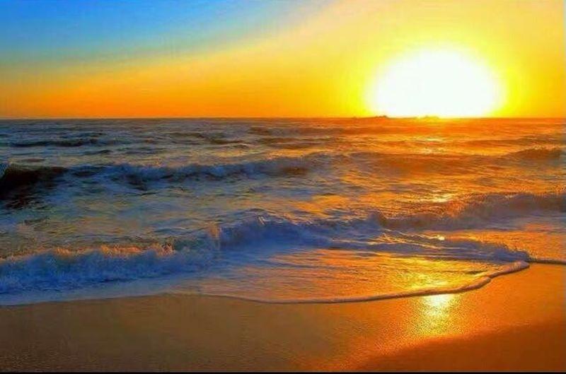 Sunset over Australia. Water Wave Sea Sunset Multi Colored Yellow Horizon Sunlight Sun Reflection Tide Coast