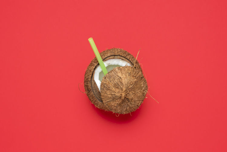 High angle view of strawberry against red background