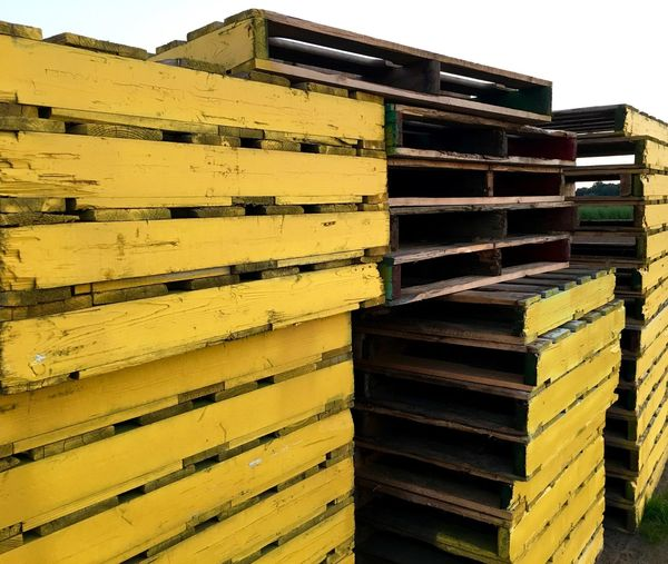 Stack of wooden palettes in warehouse