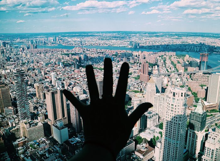 EyeEm Selects Architecture Human Hand Sky Cityscape Building Exterior Gesturing Cloud - Sky Built Structure Outdoors Day Human Body Part One Person City Close-up People