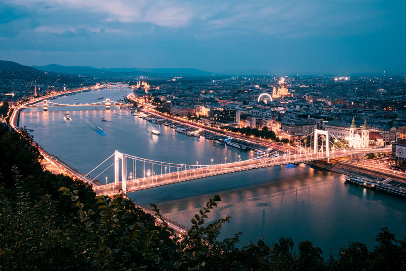 Long exposure high angle view of bridge over river by night in budapest