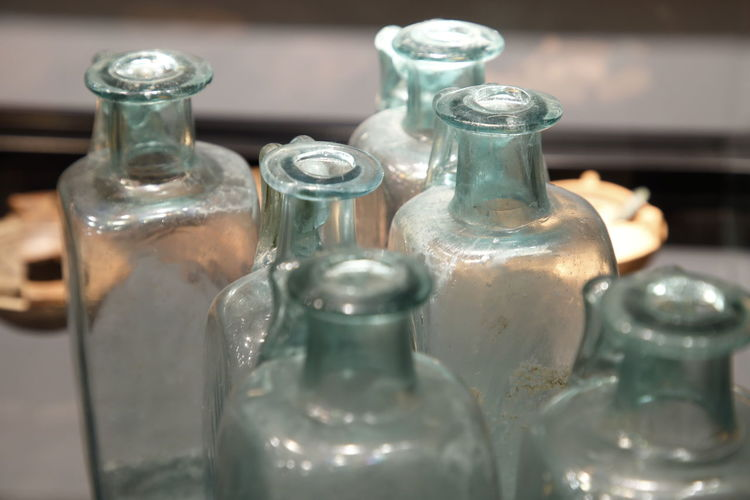 Close-up of empty glass container on table