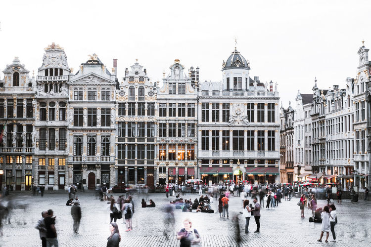People milling around in the square at La Grand-Place, Belgium The Grand Place Tourist Tourist Attraction  Architecture Building Building Exterior Built Structure City City Life Crowd Group Of People History La Grand Place Large Group Of People Outdoors Real People The Past Tourism Tourist Tourist Destination Touristic Destination Town Square Travel Travel Destinations