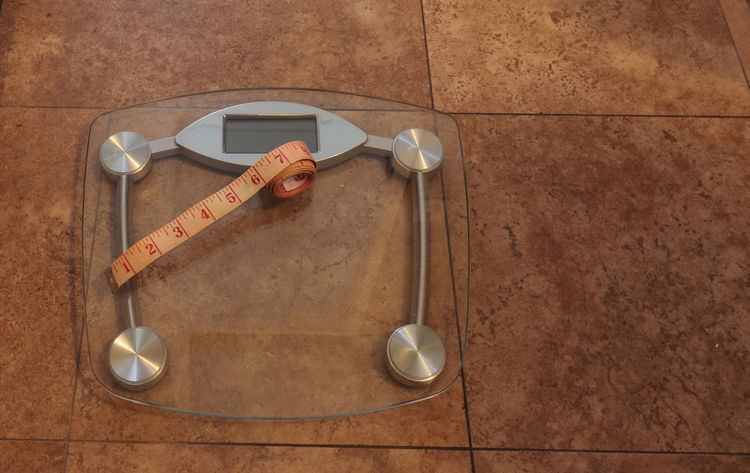 Scale to monitor weight with a measuring tape to take measurements to keep track of physical fitness Bathroom Scale Diet Fitness Health Health And Fitness New Years Resolution  Physical Fitness Scale  Tape Measure Tape Measures Weight Weight Loss Weight Loss Progress.