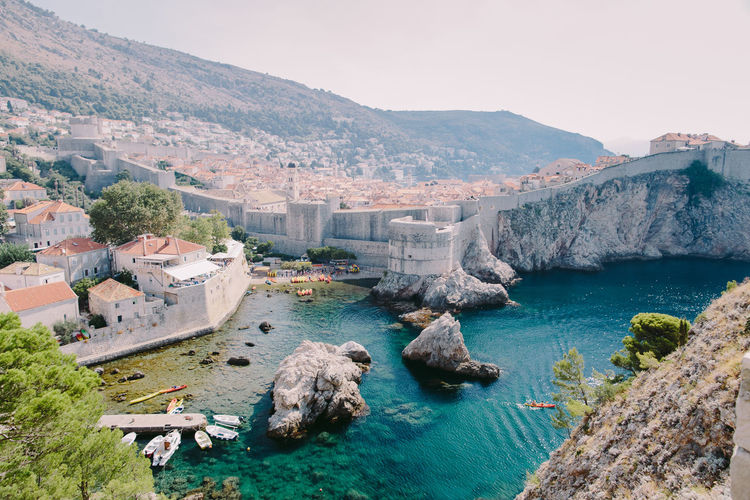 Dubrovnik Old town view at sunrise in summer Beautiful Croatia Dubrovnik, Croatia EyeEm Best Shots Architecture Beauty In Nature Clear Sky Day Dubrovnik Mountain Mountains Nature No People Outdoors Picturesque Rock - Object Scenics Sea Sky Summer Sunrise Travel Destinations Water