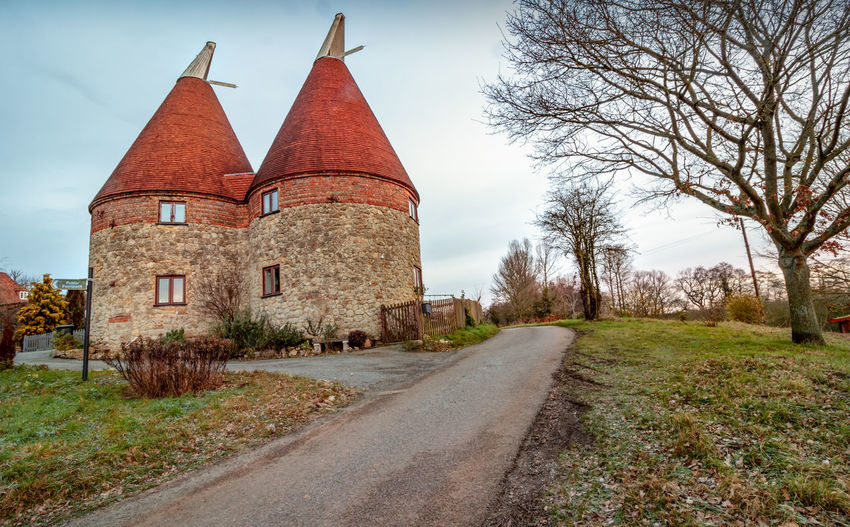 Oast House, Lenham Heath, Kent, England. Pathway Beer Hops Travel Tourism Counrtyside Rural Scene Architecture Garden Of England Oast House Brewing Vacations History Tranquility EyeEm Kent Getty Images Built Structure Building Exterior Building Outdoors Tree