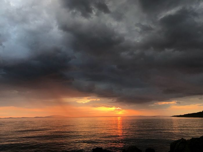 Sun and Magic Skylovers Natureandsky Magic Weather Summer Sun Sunsetstorm Sunset Stormy Weather Islandpag Sky Cloud - Sky Water Sea Scenics - Nature Beauty In Nature Dramatic Sky Sunset Nature Storm Horizon Over Water Cloudscape Outdoors Storm Cloud No People Horizon Orange Color