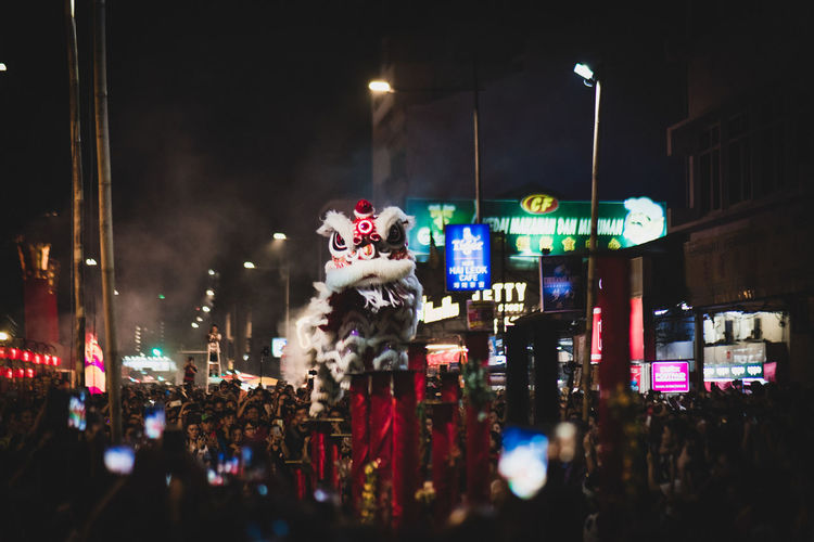 Lion Dance Illuminated Night City Architecture Building Exterior Built Structure Street Real People Crowd Large Group Of People Group Of People Celebration Outdoors Incidental People Lifestyles City Life Women Multi Colored Chinese New Year 2019 Lion Dance Performance