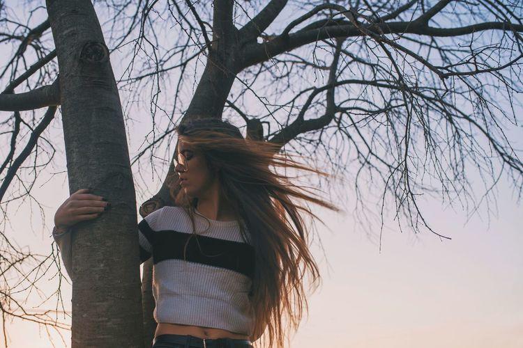 Tree Young Women Women Standing Sky Branch Woods Tree Trunk Tousled Hair Boho Fallen Tree Streaming Hair Toss
