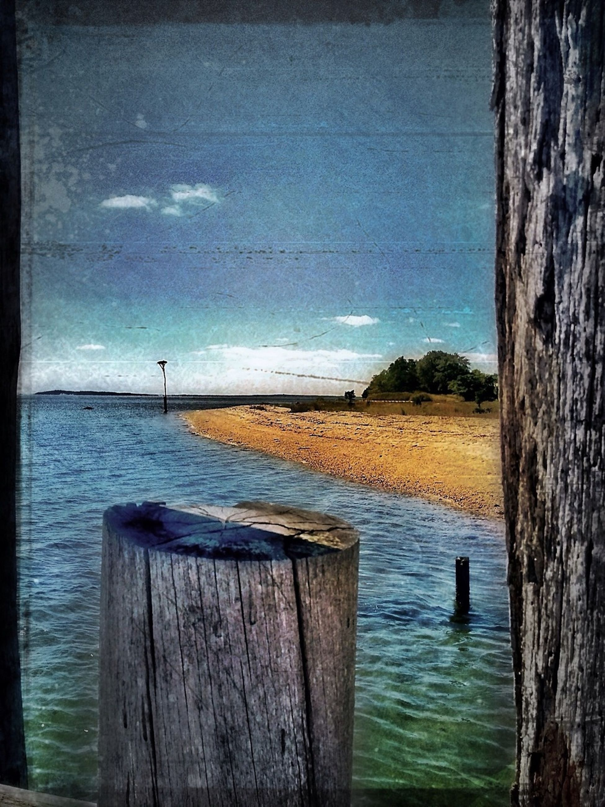 water, sea, tranquil scene, tranquility, wood - material, horizon over water, sky, scenics, beauty in nature, nature, blue, wood, wooden post, wooden, idyllic, beach, pier, cloud, ocean, calm