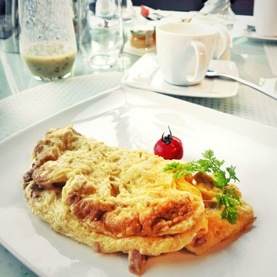 High Angle View Of Omelet And Tomato On Plate In Restaurant
