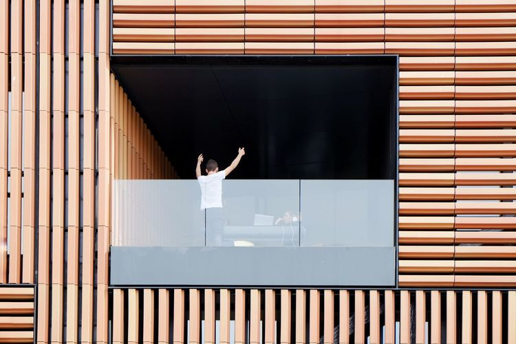 Streetphotography Street Photography Streetphoto People Candid Façade Building Exterior Building Balcony Wood - Material Human Hand Human Arm Arms Raised Limb Urban Scene Exterior Tall Office Block Residential Building Wooden Residential Structure Casual Settlement