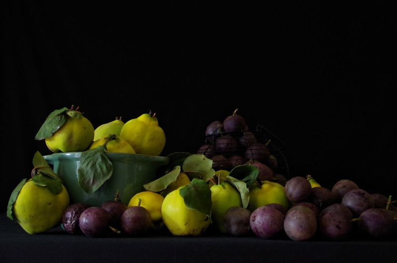 Close-up of apples and fruits against black background