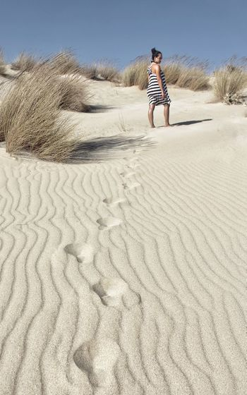 Full length of man on sand at beach