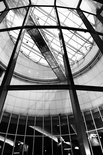 Dans le patio Low Angle View Architecture Built Structure No People Pattern Indoors  Full Frame Metal Glass Shape Glass - Material