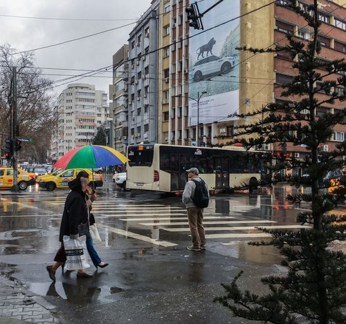 Street Real People Wet Rain City Outdoors Walking Road Built Structure Building Exterior Two People Lifestyles Sky Architecture Day Cloud - Sky Men Water People Adult Bucharest Romania