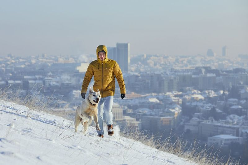 View of a dog standing on snow