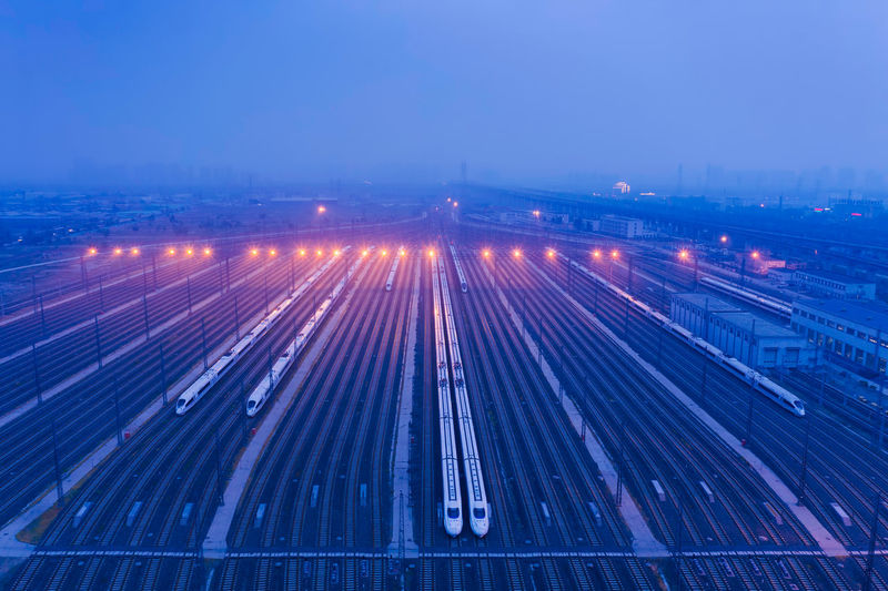 Railway, city, high-speed rail, travel Travel Train Train Station Outdoors No People Sky High-speed Rail City Cityscape City Lights Railway Night Nightlife Illuminated Motion Long Exposure Transportation Architecture Road High Angle View Speed Traffic Mode Of Transportation City Life Blue