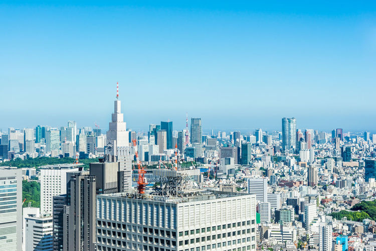 Asia Business concept for real estate and corporate construction - panoramic modern city skyline aerial view of shinjuku area under bright blue sky and sun in Tokyo, Japan Japan Tokyo Shinjuku City Urban Skyline Blue Sky Cityscape Bright Light High Office Building Aerial View Modern Architecture Panoramic Photography Background Skyscraper ASIA Real Estate Agent Business Concept Corporate Construction Landmark Tower Travel Sun Summer Downtown