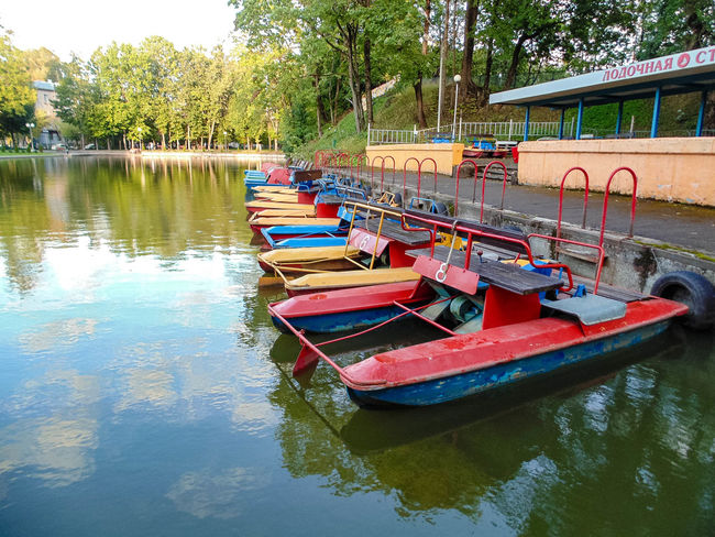 Beauty In Nature Boat Day Lake Mode Of Transport Moored Nature Nautical Vessel No People Outdoors Pedal Boat Reflection Scenics Sky Tranquility Transportation Tree Water Waterfront