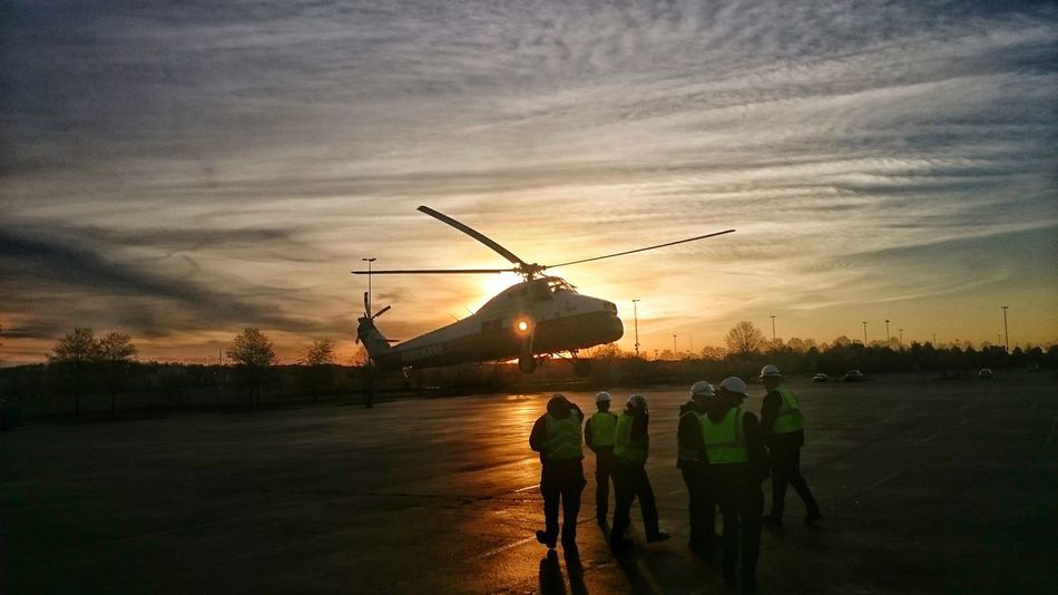 Helicopter touchdown at sunrise at concord mills mall in Concord, NC Teamwork People Helicopter Helicopter 🚁 Sunrise Silhouette Men At Work  Helicopter In Action Helicopter Parking Helicopter Landing Dramatic Sky Dramatic Clouds Sunrise_Collection No People Hidden Beauty Dramatic Sunset_collection Sky