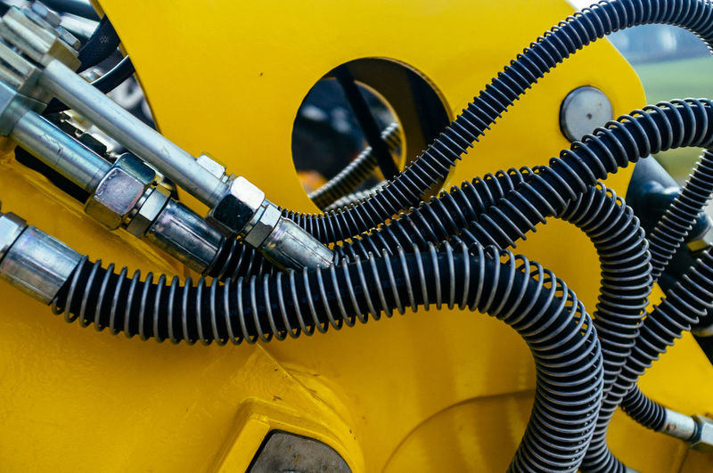 Cropped image of yellow vehicle