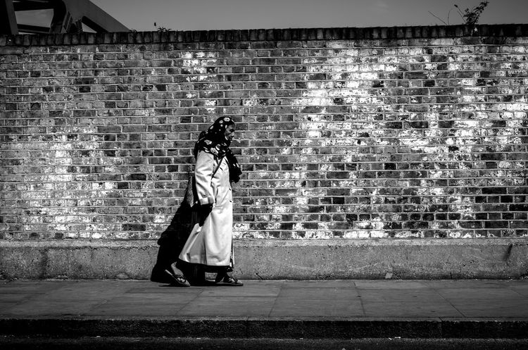 Brick Wall Full Length Leica Leicacamera Leicaxvario Lifestyles London London_only Maxgor Maxgor.com Pattern People Rawstreets Real People Street Street Fashion Street Photography Streetphoto Streetphoto_bw Streetphotography Wall Wall - Building Feature