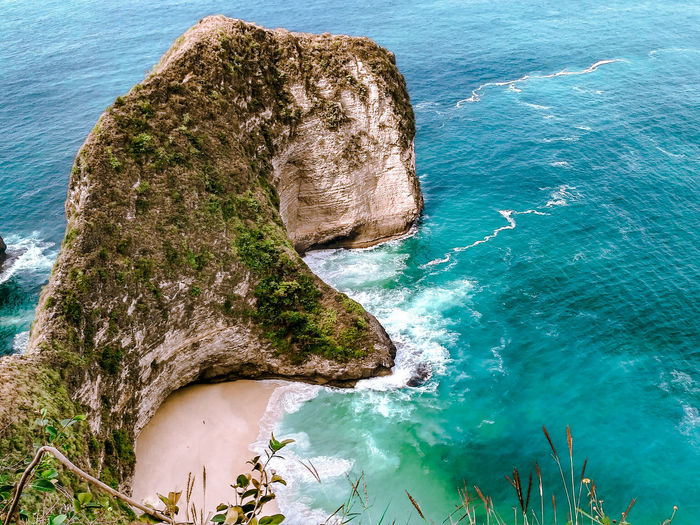 icon of nusa penida island, bali, indonesia Ocean INDONESIA Bali Cliff Landscape Hill Seascape Sea High View Water Sea Rock - Object Reflection Sky Natural Arch Stalactite  Horizon Over Water Calm Shore Sandy Beach Seascape Rock Wave