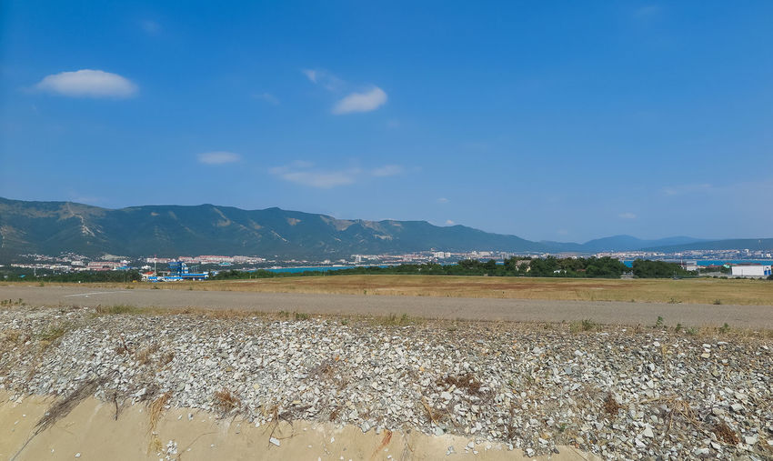 View of the runway and mountains Sky Mountain Scenics - Nature Land Water Tranquil Scene Beauty In Nature Environment Tranquility Beach Nature Landscape Day Cloud - Sky Sea Mountain Range No People Non-urban Scene Outdoors Salt Flat