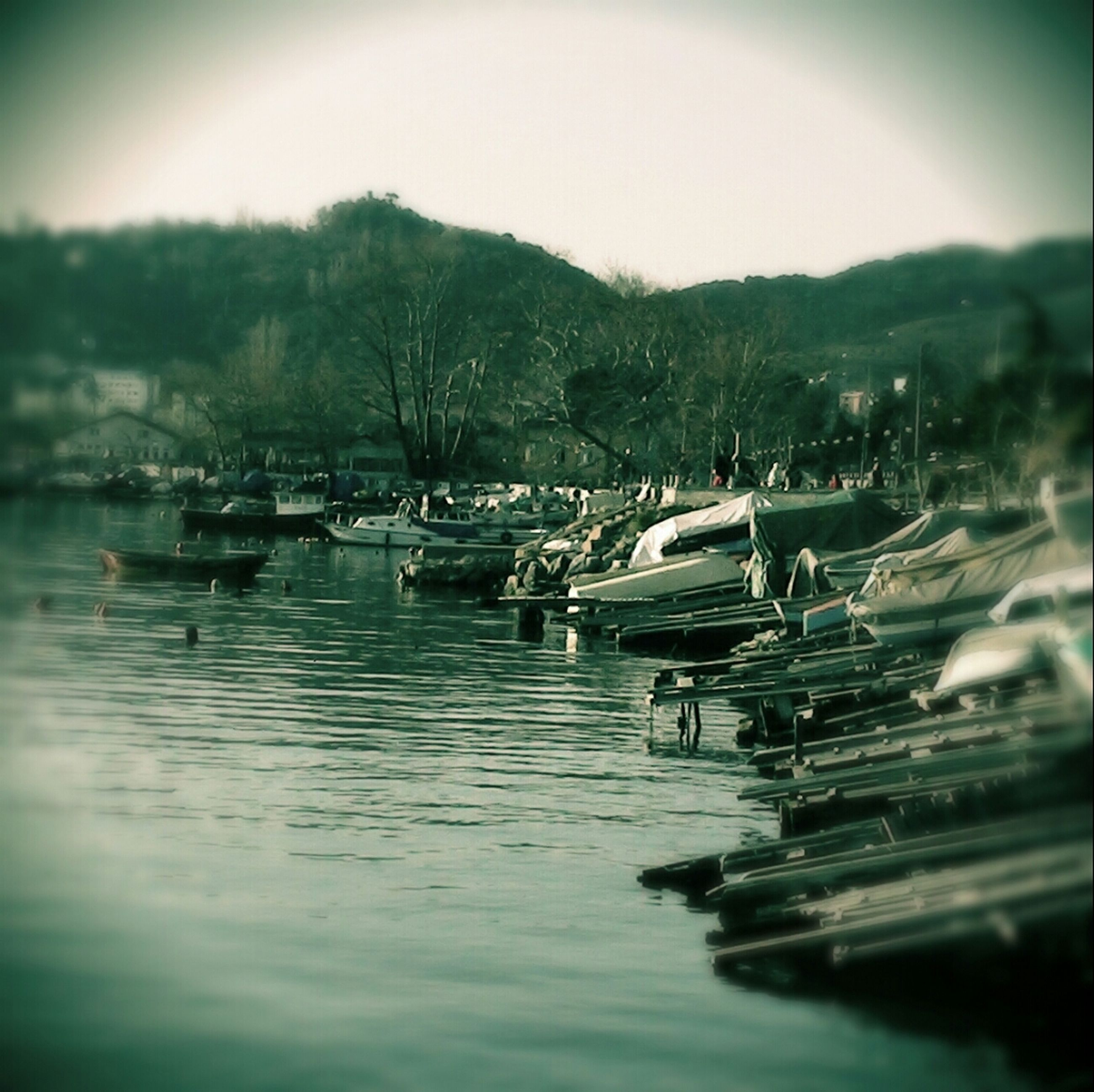 water, waterfront, tranquil scene, tranquility, lake, nature, scenics, tree, mountain, nautical vessel, reflection, boat, river, beauty in nature, sky, clear sky, day, idyllic, moored, outdoors