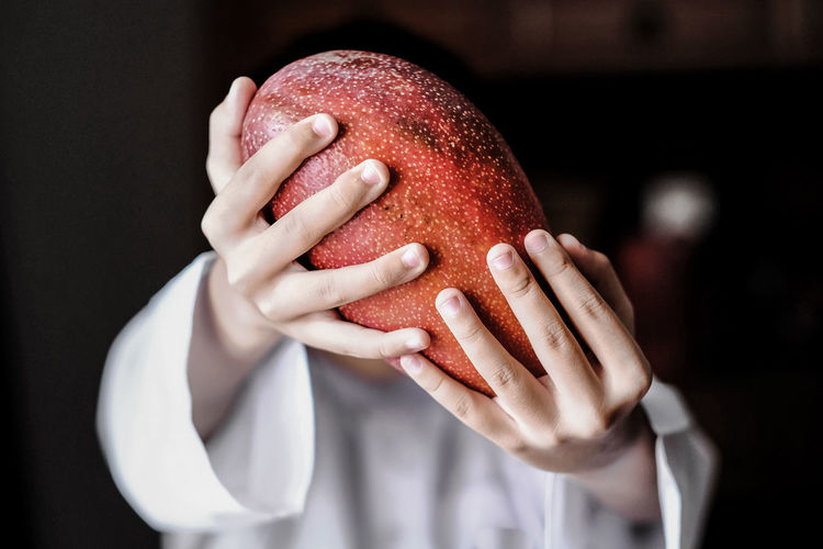 Eyrfan In The Kitchen Exotic Tropical Fruits Black Background Close-up Covering Focus On Foreground Food Food And Drink Fruit Hands Covering Eyes Healthy Eating Holding Indoors  Manggo Obscured Face Red Unrecognizable Person The Still Life Photographer - 2018 EyeEm Awards
