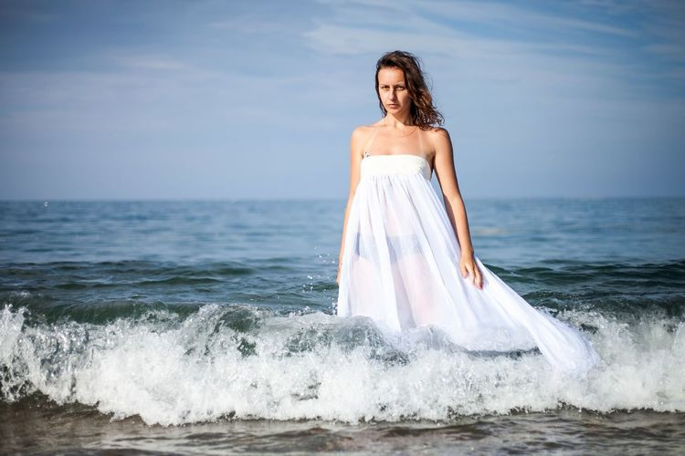 Sea Beach Sand Adults Only Only Women Young Adult One Person Water Horizon Over Water Beauty Adult Rear View Wave Women Wedding Dress People Outdoors Vacations One Woman Only Nature