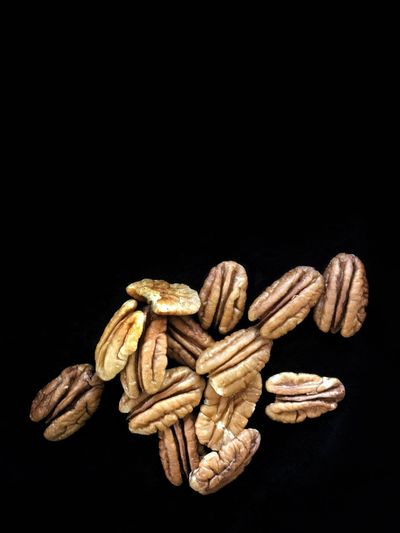 Pecan halves. Black Background Studio Shot Healthy Eating Food Close-up Vertical Pecans Pecan Tree Nuts Tree Crop Nuts Copy Space Large Group Of Objects Still Life