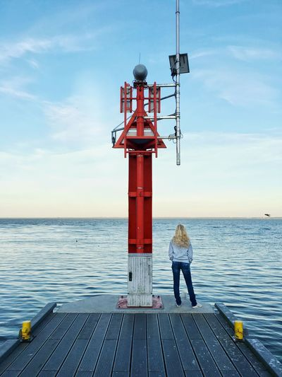 Romantic Beauty In Nature Cloud - Sky Day Full Length Guidance Horizon Horizon Over Water Lighthouse Looking At View Nature One Person Outdoors Pier Protection Real People Rear View Safety Scenics - Nature Sea Security Sky Summer Water
