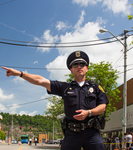 Police officer directs foot traffic at a Hillary Clinton campaign stop Campaign Stop Direction Hillary Clinton Police Officer Protestor Exceptional Photographs The Photojournalist - 2016 EyeEm Awards The Portraitist - 2016 EyeEm Awards The Street Photographer - 2016 EyeEm Awards