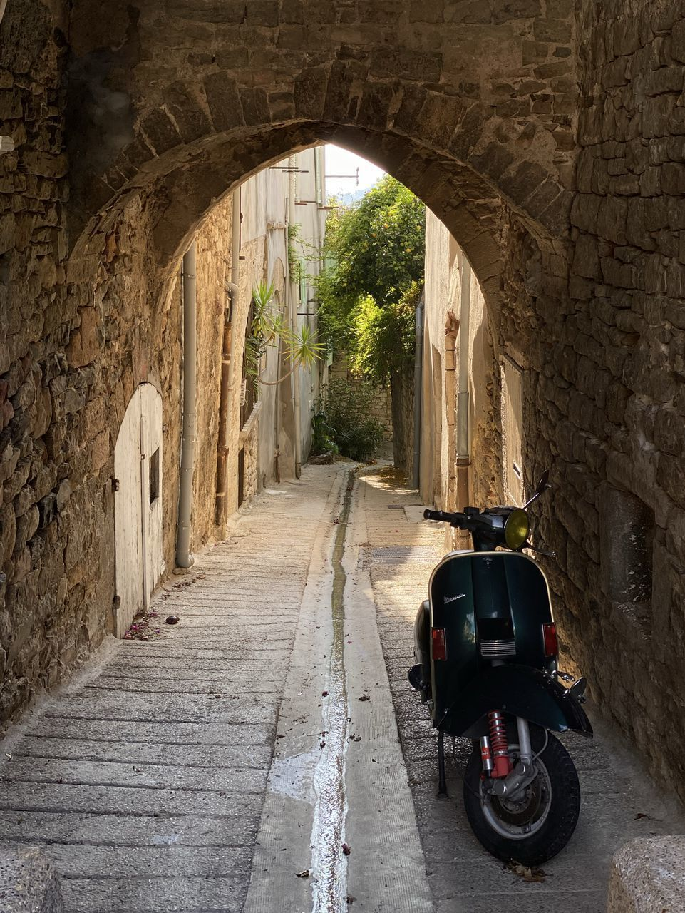 arch, built structure, architecture, transportation, the way forward, direction, mode of transportation, day, travel, land vehicle, road, building exterior, outdoors, history, nature, tunnel, old, building, the past, wall, no people, alley, architectural column, stone wall
