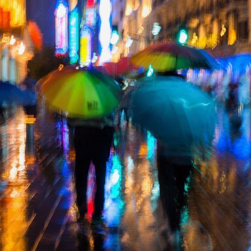 Blur Motion Blurred Motion City City Life City Street Illuminated Movement Photography Multi Colored Night Rain Rainy Season Rear View Shanghai Street Walking Wet