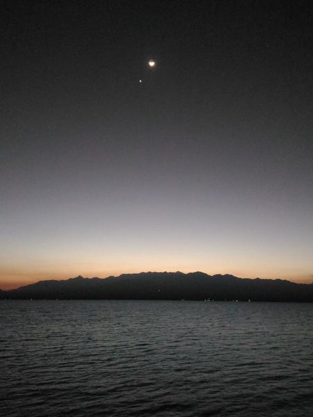 pantai lawata Astronomy Astrology Sign Space Star - Space Moon Clear Sky Water Crescent Mountain Lake First Eyeem Photo