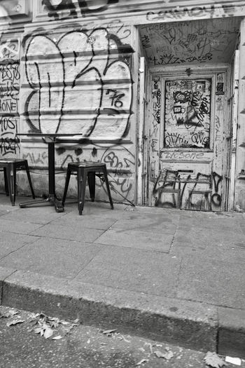 Absence Architecture Art And Craft Building Building Exterior Built Structure Chair Creativity Day Empty Flooring Graffiti Mural No People Outdoors Representation Seat Text Wall - Building Feature