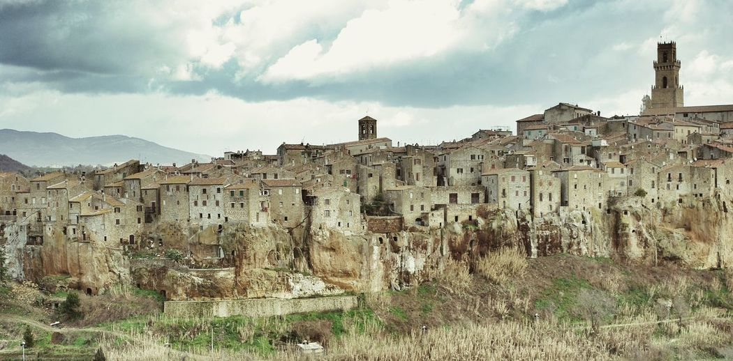 Houses in pitigliano against sky