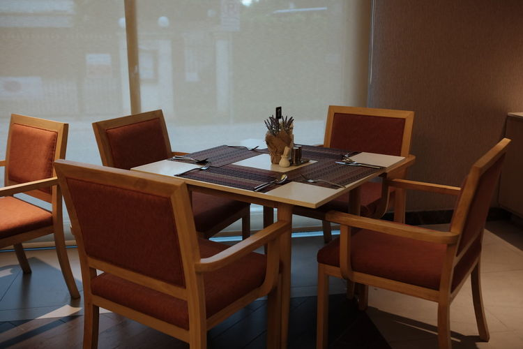 High angle view of empty chairs and tables in restaurant